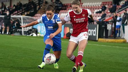 Birmingham City's Jamie-Lee Napier (left) and Arsenal's Vivianne Miedema battle for the ball