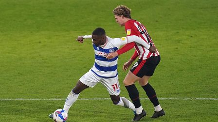 Queens Park Rangers' Bright Osayi-Samuel (left) and Brentford's Mads Bech Sorensen battle for the ball during the Sky Bet Cha...