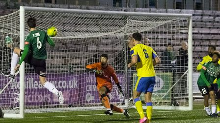 Tommy Smith connects with a cross at the far post and fires the ball back into the danger area (Pic: DBeech Photography)