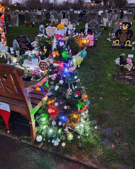 Christmas decorations have been put up near to the children's graves at the Crow Lane cemetery in Romford. Picture: Kay Pace