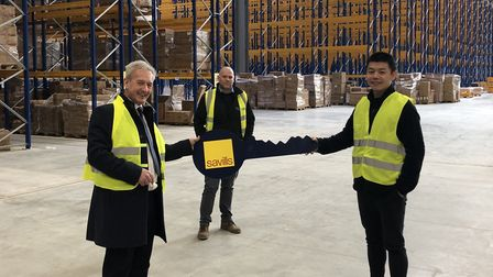 From left, Chris Moody of Savills, Matt O?Malley from Curzon de Vere and Sheng Li from FDS at the online retailer's new...