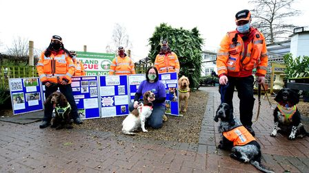 London Search and Rescue's dog team with garden centre manager Rachel Patey (centre). Picture: Polly Hancock