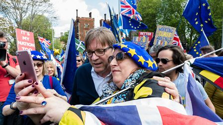 Guy Verhofstadt, European Parliament's chief Brexit negotiator, poses for a selfie as he joins a gro