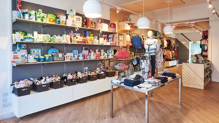 A brightly lit shop with children's products on the shelves.