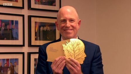 KensingtonPrimary School headteacher Ben Levinson proudly holding the Pearson national teaching gold award for making a...