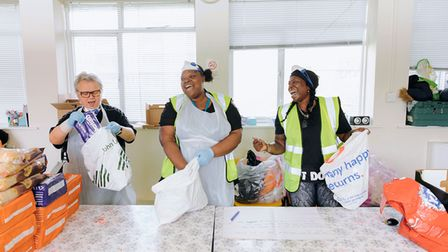 The Hackney Community Food Hub team packing bags and having a laugh.