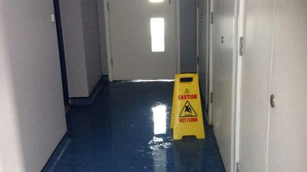 A corridor with water in it