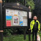 Park warden Julie with the poster on display.