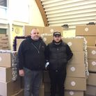 Peter and Mark McCabe fromAGS Doors and Shutters with the donation of hampers.