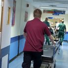 A porter pushes a trolley at the Royal Liverpool University Hospital, Liverpool.