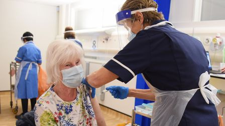 Carole Smith, 82, has her Covid-19 vaccination administered by Helen Lloyd, senior nurse, at the Nor