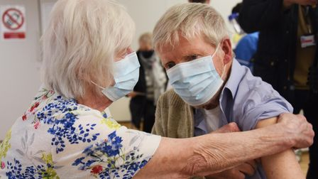 Carole Smith, 82, helps her husband, 86-year-old Tony, get ready for his Covid-19 vaccination at the