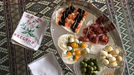 A tray of bowls of nibbles and canapes