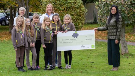 Curo's Jodie Winter presenting First Yatton Brownies with a cheque for £200.