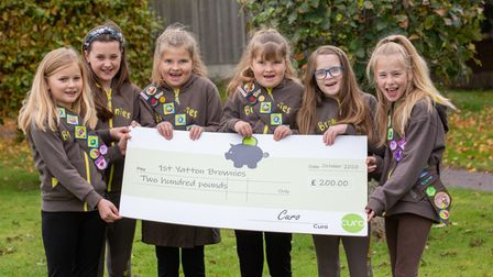 First Yatton Brownies holding a £200 cheque.