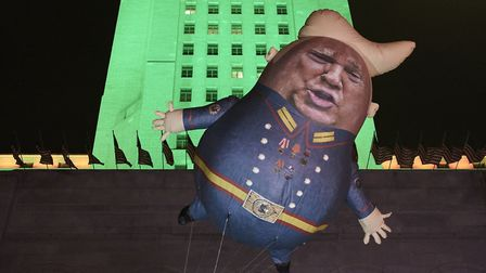 A Baby Trump Balloon floats outside City Hall in Los Angeles. (AP Photo/Damian Dovarganes)