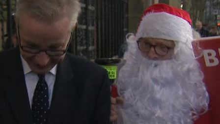 Michael Gove is chased by an anti-Brexit Father Christmas. Photograph: Sky News/Twitter.