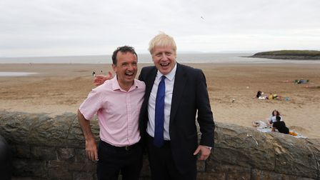 Boris Johnson with Alun Cairns during a visit to Barry Island in South Wales. (Frank Augstein/PA)