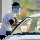 Samples are taken at a coronavirus testing facility in Temple Green Park and Ride, Leeds, as NHS Tes