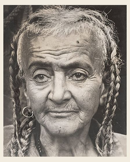 Close up of a woman's face with braids.