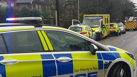 A police car blocks Unthank Road while a house fire is investigated