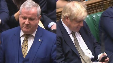 SNP Westminster leader Ian Blackford criticises Boris Johnson for playing with his phone. Photograph