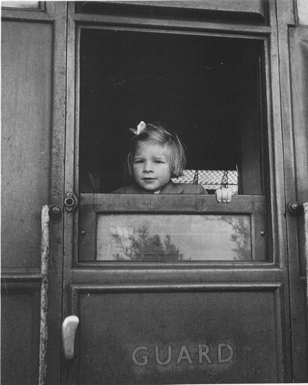 Young Sheila Hutchinson peeping out of the guards van at Berney Arms.