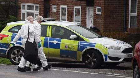 Forensics officers at the scene of a fatal stabbing at Affleck Road in Colchester.