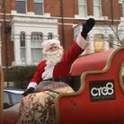 Santa waving to the crowds on his sleigh in Cecile Park