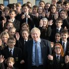 Prime Minister Boris Johnson during a visit Chulmleigh Community College pictured with students whil