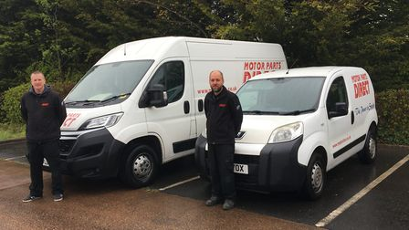 From left, Chris Large, assistant manager at Motor Parts Paignton, and Glenn Bristow, manager, donat