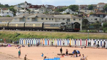 The 277 passes holidaymakers on Goodrington Sands, Paignton, on the Dartmouth Steam Railway Photo: G