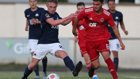 Owen Price battles for the ball with Niall Heeney of Bideford AFC during a pre-season friendly betwe