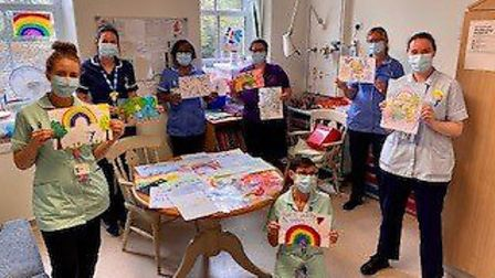 The Louisa Cary Ward team with some of the children's artwork