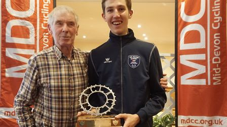 Colin Lewis presenting young starlet Harrison Wood with the President's Trophy
