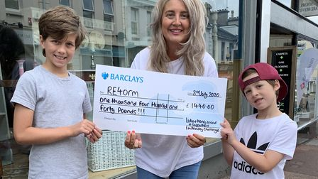 Luke and Henry Wood presenting their cheque to Katie Cavanna of RE4orm