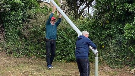 Colin Hedworth and Phil Lyons erect the Palace Hotel flagpole