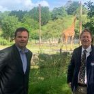 Torbay MP Kevin Foster (left) and Paignton Zoo boss Simon Tonge take a look at the giraffes