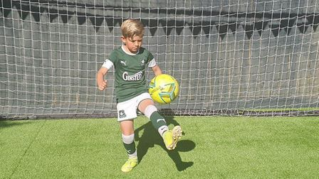 Football-mad Torquay schoolboy Cache Pearson showed true determination to raise money for the NHS