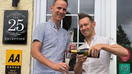 Julian and Andy Banner-Price celebrate The 25 Boutique B&B being named number one in the world for s