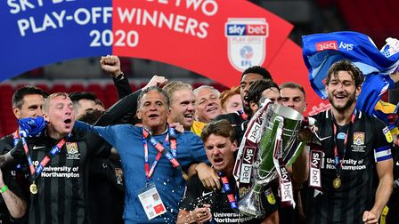 Keith Curle, manager of Northampton Town, celebrates the play-off final victory with his teamPhoto