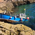 Tony Young's fishing vessel began to fill with water at sea.