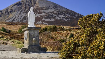 Ireland, County Mayo, Murrisk. The holy pilgrimage mountain of Croagh Patrick with a statue of Saint