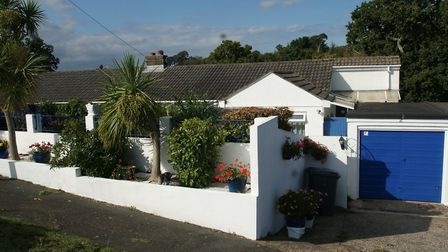 The property is quite concealed from the road and is accessed via a private courtyard garden