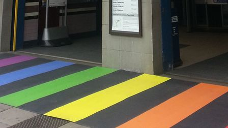 Rainbow colours on the pavement outside Arsenal Station
