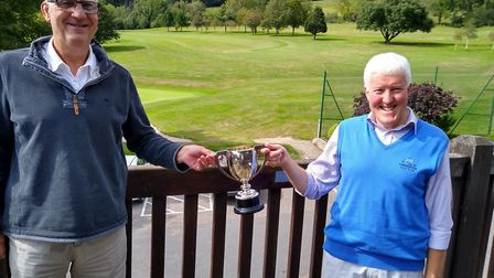 Sidmouth club captain Lester Wilmington presents John Arnott with the veterans Cup. Picture: SIDMOUT