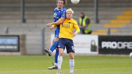 Ben Whitfield of Torquay United battles for the ball during the pre-season friendly against Chippen