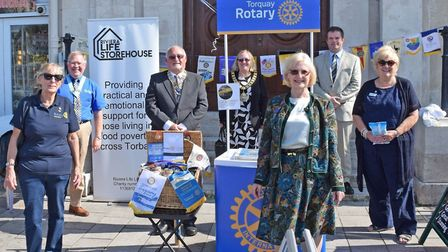Rotarians and their guests at the Harbourside ceremony - from left are Lyn Smith; Rotary District Go
