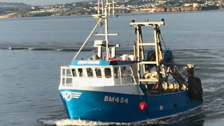 Brixham fishing boat coming into Torquay harbour