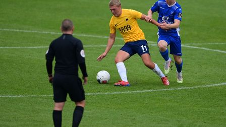 Jake Andrews of Torquay United holds off Dan Warre of Chippenham Town during the pre-season friendly